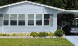 This is a 2005 Jacob with 2/2 for $70,000 and 1664 SqFt. It is a very modern home, with carpet in the rooms and hardwood floors in the main rooms. Corriane counter tops and wood pine cabinents, spacious master bed room with bath, his/hers sink, laundry