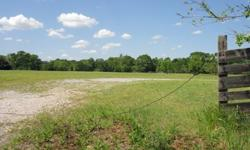 2.4 +/- Acres Country Setting Close To Town. Corner Property With Some Tree Clusters. Utilities