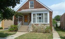 Two bedroom home in Chicago with one full bath. The home has hardwood floors through the living area. There is a living room, dining room and kitchen, along with two bedrooms each with private closets. The home has a full basment for extra storage. The