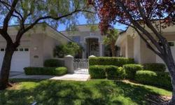 Stunning home on the TPC golf course that has had a complete remodel. Guard gated community of Country Club Hills in Summerlin. Four bedrooms, with master suite downstairs, plus one additional bedroom downstairs and two bedrooms upstairs. Remodeled
