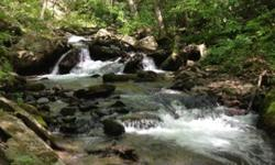 100 acres close to Asheville with big creek and views!
