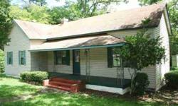 You cannot beat this for $38.48/sf!! Should cash flow pretty easily! Lots of room for the $$$$$! Covered front porch, deck, screened porch in back, pole barn-type structure could be a carport, tons of room inside, fireplace, 5-min. to I-10 - all on 1.91