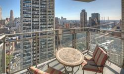 This magnificently designed apartment of approximately 1500 square feet offers views, beauty and wonderful use of space. It contains a vast expanse of white marble floors, new large sound proof windows encompassing light and panoramic views of the city