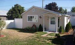 Take A Look At This One! SUPER CUTE! So much is new inside and out! New roof, vinyl siding and windows, including vinyl fencing. New interior floors, with cork in the bathroom withgranite surface. New paint and insulation. Large bedroom and kitchen.