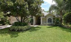 The Stonegate home that you have been waiting for. Open and upgraded 4 bedroom 3 bath home on a .68 acre tropically manicured lot. The chef of the family will love the spacious kitchen complete with granite counter tops, island, pantry, desk, and eat-in