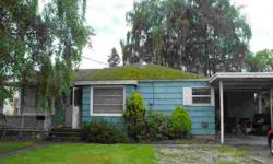 This house is a Fixer waiting for your special touches. Coved Ceilings, built in cabinets, Office can be used as a 3rd bedroom but currently does not have a closet. One car carport with a Office/room and a enclosed porch. Large backyard with lots of room