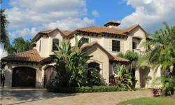 SHORT SALE- This Custom Built Mediterranean Style Luxury Home built by Campagna Homes is Located in the Private Gated Country Club Community of Champions Club. It sits on an Oversized Premium Golf Course View Home site with a Lusciously Landscaped yard