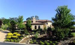 Custom Mediterranean residence in gated Kalithea-Promontory neighborhood. Round foyer entry, Italian-Villa-style central courtyard, gourmet kitchen with butler's pantry, formal dining room, upstairs master retreat with sitting area and balcony, 4 car