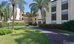 Very well-maintained end unit with view of golf course and pool. Wood floors, shutters, screened lanai, extra storage and covered parking. Excellent community near downtown Naples.Listing originally posted at http