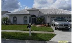 """This home is located in the desirable """"Estates"""" subdivision and overlooks the Links golf course. The 4 bedroom/2 bath/2 car garage pool home is absolutely gorgeous and ready for you to move right in. The home offers a split bedroom plan and the master su"""