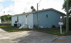 Great Deal for 3/2 waterfront property with Gulf Access! Large covered screened patio overlooking the water with extra parking area for RV or boat. This double wide mobile home is at the end of a quiet cul de sac with extra storage shed outside. Needs a