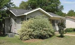 This is a classic four bedroom, two bath in the absolute heart of Waco. Hardwood floors, wear resistant carpet, and fantastic wooden paneling on the walls give this house a rich, decadent feel. Great kitchen countertops and fully tiled bathrooms are only