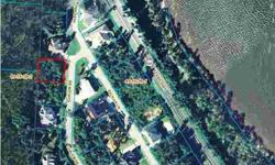 One of the few remaining building lots in NorthEast Pensacola's upscale subdivision of Macky Bluffs. Located just off Scenic Hwy with a fantastic Water View. Lot is high and dry, treed and perfect to build your dream home.