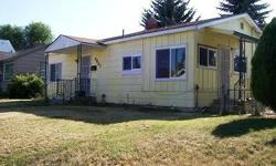 Great first time buyer or investor home. Kitchen has new tile floor,new vinyl windows,counter tops, paint.Hardwood floors in LR,Hall,1 bedroom. Bath is process of being remodeled. Lovely back yard for the kids and pets. Take a peek.Listing originally