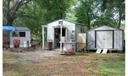 BEAUTIFUL WOODED AREA WITH MATURE LANDSCAPING - GROW YOUR OWN VEGETABLES AND FRUIT TREES. EASY ACCESS TO SHOPPING WITHIN 10 MINUTES. NICE COUNTRY ATMOSPHERE. Bedrooms: 2 Full Bathrooms: 1 Half Bathrooms: 0 Lot Size: 0 acres Type: Single Family Home