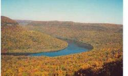 Come build your dream home on the Elder Mountain brow overlooking the panoramic Tennessee River Gorge. The property is located on the South Point at the end of a cul-de-sac with stunning views in this exclusive mountain community which offers a guard