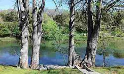 Flat lot in a access controlled community in the middle of Wimberley. Access to river front park with beautiful large oak trees.