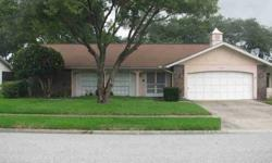 This beautiful 3/2/2, 1771 sq. ft. home sits on beautiful manicured park like setting, fifth of an acre lot. The home features 8ft. ceilings, living/dining room combo, split bedroom floor plan, eat in kitchen with new stainless steel refrigerator. family