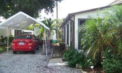 Single Wide mobile home in quiet 55 plus Private Park, Great location, big lot with plantings and private yard and covered patio, W/D in home and onsite,berber carpets, covered parking, Community center for residents, Custom master bedroom, Florida room.