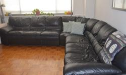 """Large, black, leather sectional sofa in perfect condition. Extremely comfortable as well! 3 sections that form an """"L"""" or middle can be taken out and used as a large chair. Each portion of the """"L"""" is 10.5 feet.Roughly 3 feet deep."""
