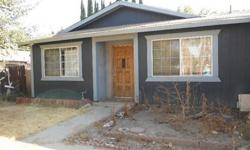3 bed 2 bath in Clovis - NEEDS TONS OF WORK! MUST SELL!!Could be a great property to fix and flip or even a possible rentalProperty is in desperate need of new carpet and paint.There is most likely mold in the kitchen.Please call me for more details.Raul