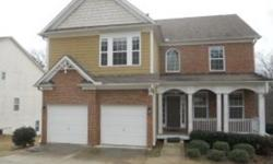 Formal living and formal dining area, open foyer entrance with hardwood floors, family room with fireplace. Kitchen with corian counter top, pantry, built in microwave and breakfast area, rear deck. Master bedroom with garden tub, separate shower and dual