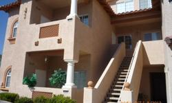 Spacious 2 story condo w/ 2 beds, den + loft. Tile floors, breakfast bar, recessed lights, tiled countertops in kitchen. Living room has vaulted ceilings, fireplace & wood flooring. Dual walk-in closets in master bedroom. Master bath has double sinks,