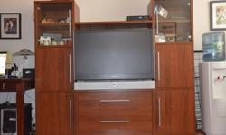 """Large and very functional wall unit in fantastic condition. There is a copious storage for electronics, books, etc. Accommodates most 42"""" TVs.Dimensions"""