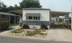 Really nice 2 bedroom, 1 bath mobile home, with beautiful puergo floors, nice appliances and convenient to many publice services, including retail, grocery, banking, public transportation and pharmacy. Covered carport and covered front porch.Listing